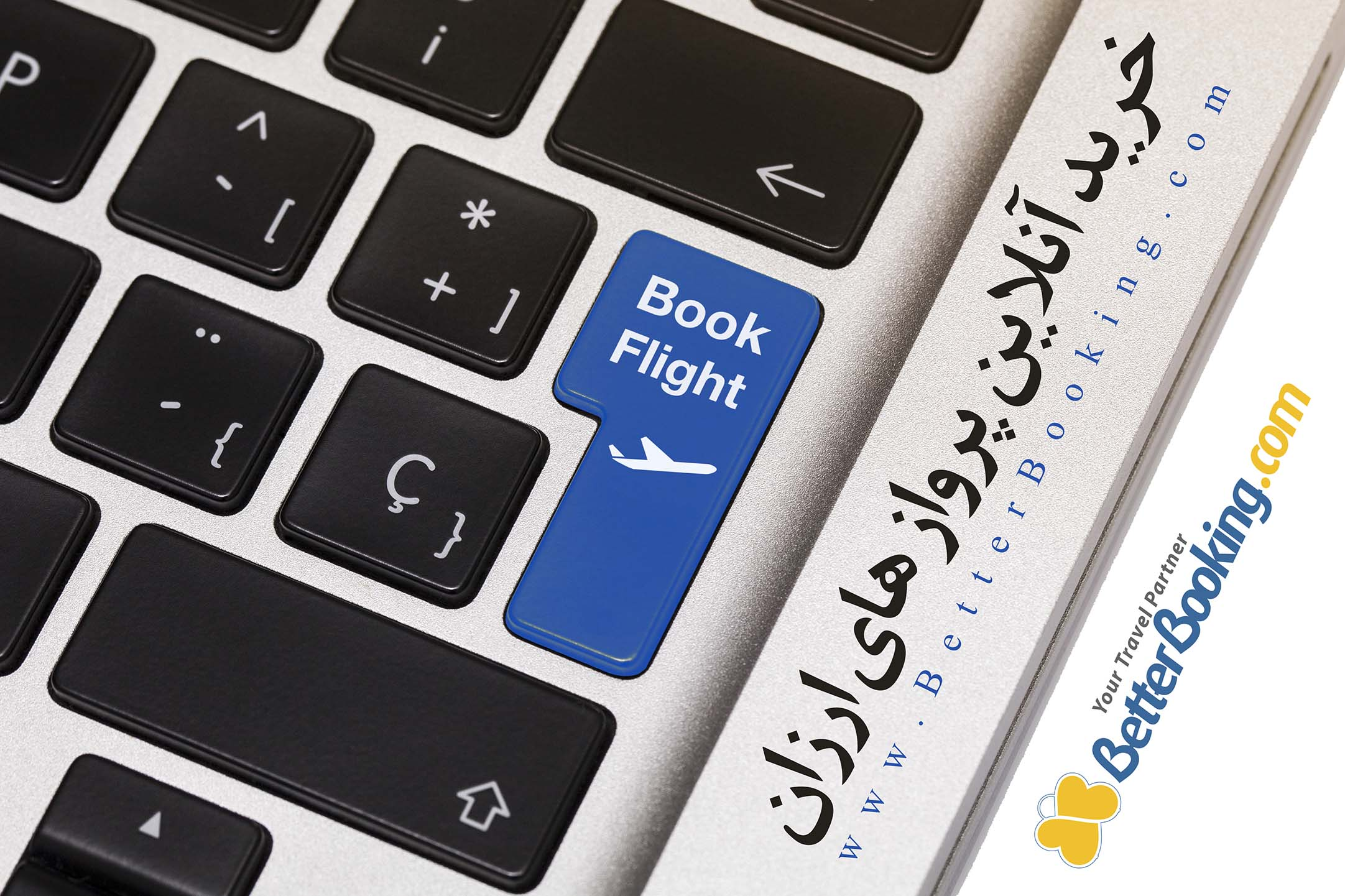 """Laptop key showing the word """"book flight"""", in blue color."""